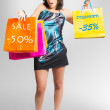 Foto Stock: Beautiful girl goes shopping