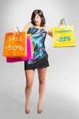 Beautiful girl goes shopping — Stock Photo