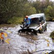 Stock Photo: SUV overcome water obstacles.