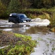 Stock Photo: SUV in river