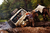 SUV overcomes mud obstacles. — Stock Photo