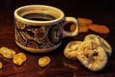 Dried fruits and coffee — Stock Photo