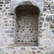 Niche in antient stone wall — Stock Photo #25241033