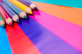 Colorful pencils on colored paper — Stock Photo