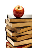 Stack of Old Books With an Apple on Top — Stock Photo