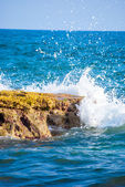 Rock and waves in sea — Stock Photo