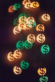 Bokeh in shape of dollars — Stock Photo