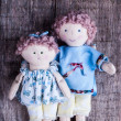 Stock Photo: Couple of dolls on wood