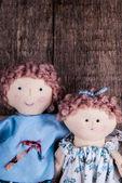 Couple of dolls on wood — Stock Photo