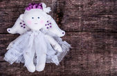 Doll angel on wood — Stock Photo