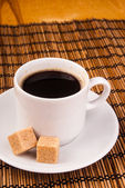 Coffe on table with brown sugar — Stock Photo