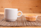 Espresso coffee in a white china cup over wood surface — Stock Photo