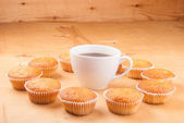 Close-up of cupcakes on wooden board. — Stock Photo