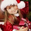 Little girl holding Christmas box — 图库照片