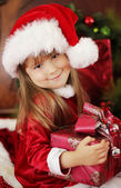 Little girl holding Christmas box — Stock Photo