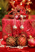 Christmas decorative balls with present — Stock Photo