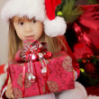 Adorable Christmas little girl with gift — Stock Photo