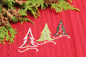 Christmas tablecloth with fir branch — Stock Photo