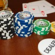 Stock Photo: Poker Dealer Button and Casino Tokens with Pair of Aces