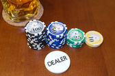 Poker Dealer Button and Casino Tokens — Stock Photo