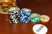 Poker Dealer Button and Casino Tokens Horizontal — Stock Photo