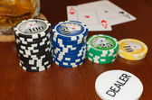 Poker Dealer Button and Casino Tokens with a Pair of Aces — Stock Photo