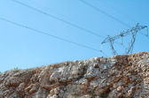 Electric Pylon over Cliff Face — Stockfoto