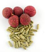 Fruits capsules on white background — Stock Photo