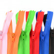 Zippers of many colors on a white background — Stock Photo