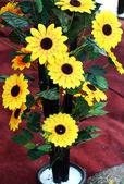 Plastic decorative sunflower sales during festive season. — Stock Photo