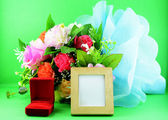 Photoframe flower and red ringbox — Stock Photo