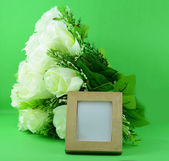 Photo frame and flowers — Stock Photo