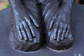 Hands of the statue. — Stock Photo