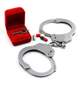 Red box for Handcuffs, Medicine and Pills — Stock Photo