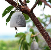 Buddhist bell. Tap to good fortune. — Stock Photo