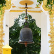 Buddhist bell. Tap to good fortune. — Stock fotografie