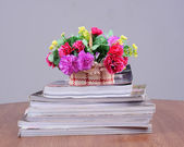 Flower vase on book — Photo
