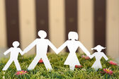 Family from paper on grass — Stock Photo