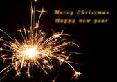 Christmas and newyear party sparkler on black — Stock Photo