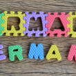 Jigsaw written Germany word on wood background — Stock Photo #36698037