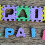 Jigsaw written Spain word on wood background — Stock Photo #36698941
