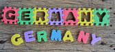 Jigsaw written Germany word on wood background — Stock Photo