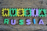 Jigsaw written Russia word on wood background — Foto Stock