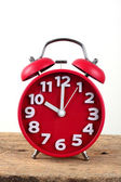 Red alarm clock, showing time — Stock Photo