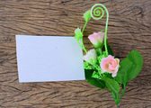 Empty paper card with spring flowers — Stock Photo