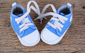 Baby sneakers on wood background — Stock Photo