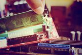 Putting RAM into the memory slot on motherboard — Stock Photo