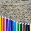 Stock Photo: Colour pencils on wood background