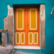 Brightly painted front door in the colourful old town of Bosa, Sardinia, Italy — Stock Photo #24262573