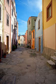 Brightly painted houses in the colourful old town of Bosa, Sardinia, Italy — Stock fotografie